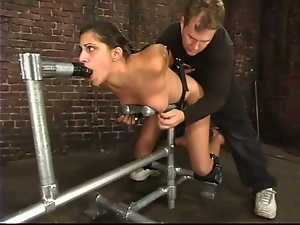 Taila MOnet is getting hogtied and tied on the device