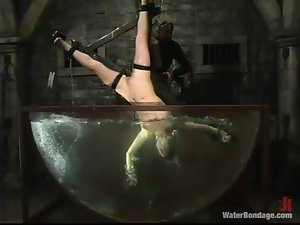 Jade Marxxx gets toyed and humiliated in water bondage show