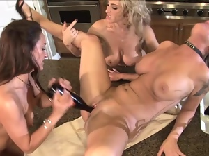 Three filthy lesbian milfs are going wild in the kitchen