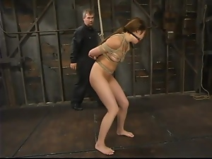 Tia Tanaka gets her legs open with a spreader bar