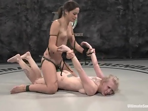 Brunette and a sexy blond are wrestling naked