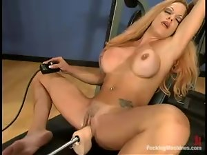 Busty Shannon Kelly gets toyed by a machine in a locker room