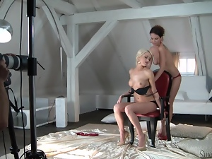 Lena Love and Eve F enjoy fingering each other's pussies in a studio