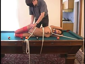 Lucury and luscious ebony is tied up on the pool table