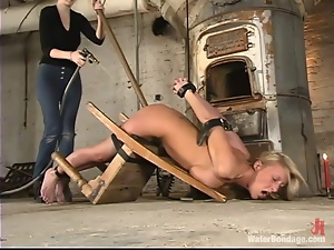 Busty blond babe Natalia gets hogtied and penetrated
