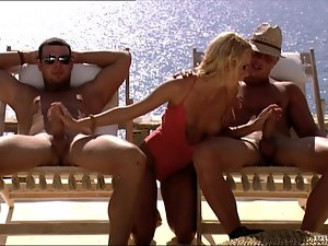 Slutty blonde gets fucked and facialed by two men outdoors