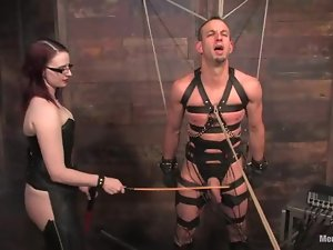 Jason Miller gets his cock beaten with a stick in BDSM scene