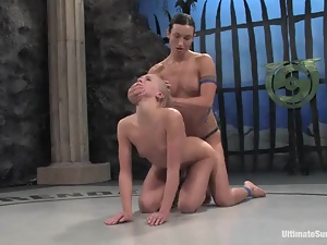 Pretty blonde girl gets toyed and punished in a ring