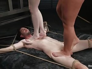 Two nasty mistresses torture a guy and ride his big cock