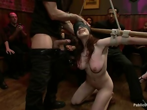 Redhead beauty gets tied up and fucked at the bar