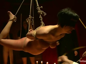 Submissive brunette slut get suspended and tortured with candle wax