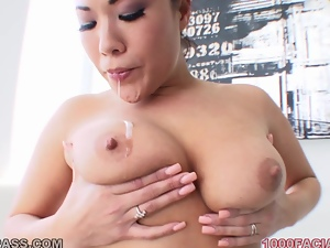 London Keyes the cute Asian girl gives a titjob and gets facialed