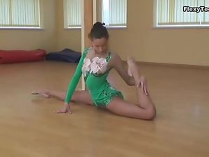 Leggy ballerina in leotard can bend her body