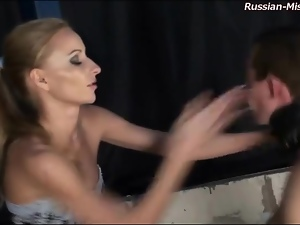 She slaps his face and spanks his ass