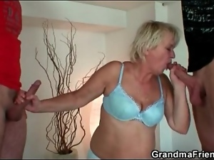Mature cleaning lady spit roasted by two guys