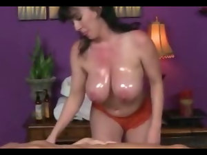 Lesbian masseuse massages with her big tits