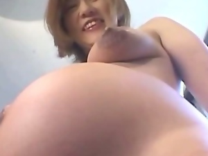 Horny guy gets a hand full of pregant lady as he feels her up