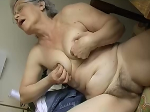Seductive white haired granny masturbates with dildo in bed