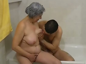 Feverish BBW granny takes bubble bath and fucks in threesome