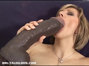 Vanessa feeds her pussy and asshole huge dildos