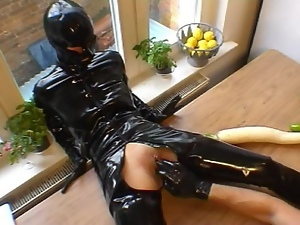 Riding the sybian in rubber
