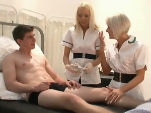 Geeky patient got his little dick wanked by two nurses
