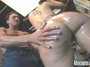 Horny tattooed bitch nailed by massive fat dong