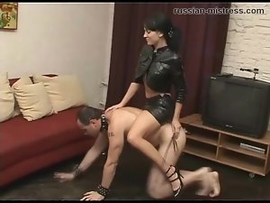Mistress in leather skirt rides him like a pony
