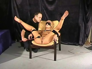 Blindfolded blonde girl smacked with his cane