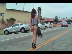 Girl walks to her car in thong bikini bottoms