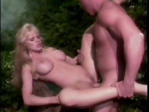 Fucking a fake tits blonde babe in the jungle