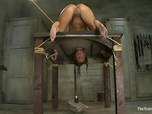 Cassandra Nix gets her pussy amazingly toyed while being in pillory