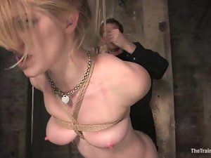 Sassy blond bends over and gets played in a bondage