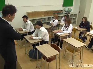 Sexy Japanese college girls suck and ride a dick in a classroom