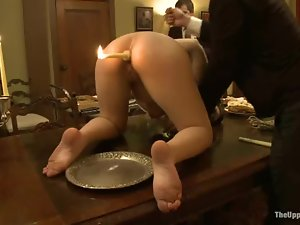 Girl with a burning candle in her ass get humiliated