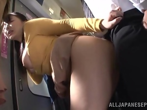 Japanese hussy gets fucked by a stranger in a crowded bus