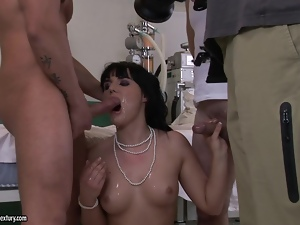Nasty brunette nurse gets rammed by two dudes in a hospital