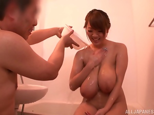 Hitomi Tanaka gets her huge tits washed and kneaded in a bathroom