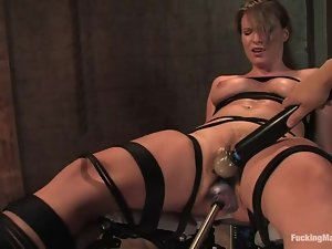 Stunning Harmony gets tied up and toyed deep by a machine