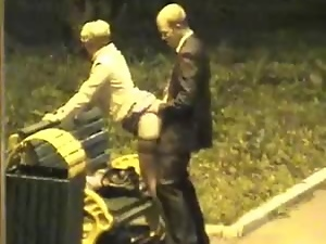 Mature hottie gets fucked from behind in a park at night