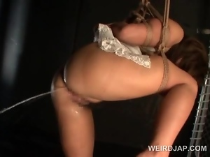 Huge titted asian sex slave in ropes gets cunt teased