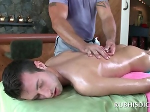 Gay masseur using a glass dildo to fuck male ass hole