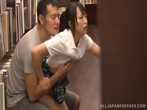 Japanese hottie enjoys rear banging in the library