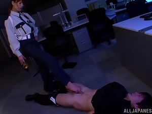 Japanese girl in police uniform gives a footjob to a burglar