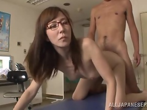 Japanese girl in glasses gets fucked nice and deep by a doctor