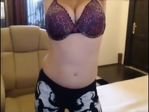 Girl withj big tits getting naked