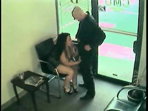 Security cam video with a brunette sucking a dick