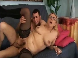 Mature blonde moans in pleasure while getting her ass pounded