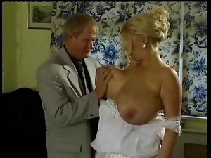 Mature blonde rides a cock and gets cum on her massive boobs