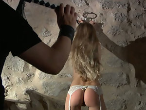 Blonde slave girl dressed sexy for kinky fantasies